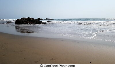 the sand coast of the Arabian Sea in India of Goa -...