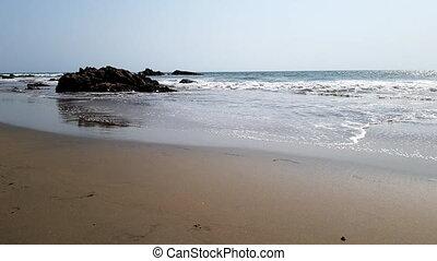 the sand coast of the Arabian Sea in India of Goa -...