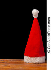 The Santa red hat on wooden background