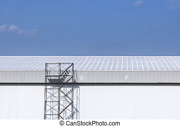 the scaffold at the factory building with the blue sky day