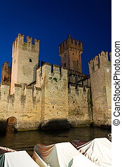 The Scaliger Castle at night in Sirmione, Italy