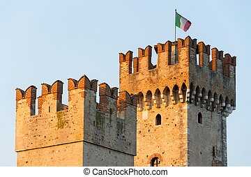 The Scaliger Castle in Sirmione, Italy during sunset