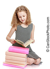 The school age girl reading a book - isolated on white ...
