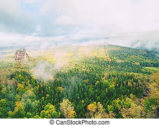 The Schramsteine and Falkenstein rocks in early autumnal view. Rocks in the Elbe Sandstone Mountains park