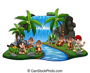 The scouts with monkeys on island waterfall