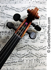 violin on sheet music - The scroll of an old Italian violin...