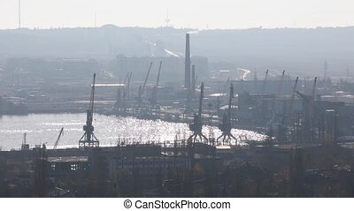 The sea port in backlighting - The sea port in action in the...