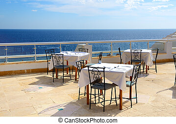 The sea view outdoor terrace of restaurant at luxury hotel,...