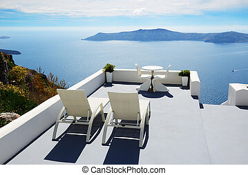 The sea view terrace at luxury hotel, Santorini island, ...