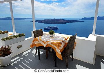 The sea view terrace in restaurant at luxury hotel, Santorini island, Greece
