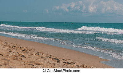 The Sea Waves are Rolling on a Sand Beach