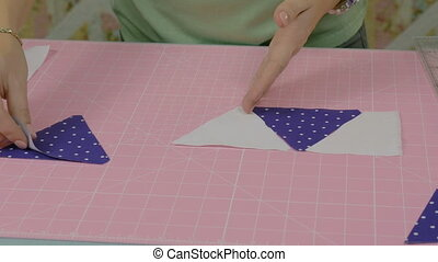 The seamstress makes a workpiece for the fabric product....