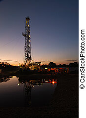 The search for natural gas continue as the sunsets on another day.