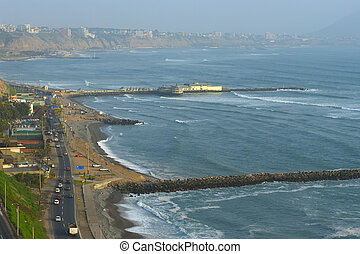 The seaside road in Miraflores and a restaurant built on the...