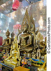 The Seated Buddha Images in Attitude of Subduing Mara and Meditation with Arch frame.