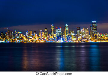The Seattle skyline and Elliott Bay at night, seen from West Seattle, Washington.