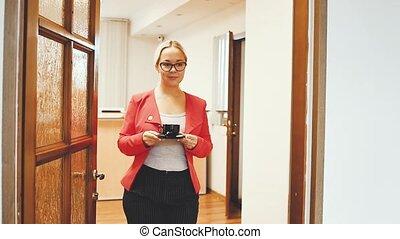 The secretary brings coffee to businessmen.