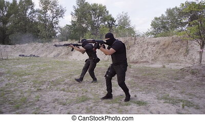 The security guards are trained to shoot guns at the shooting range.