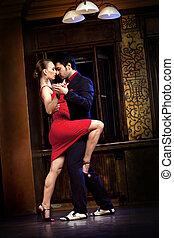 The Seduction Dance - A man and a woman dancing tango....