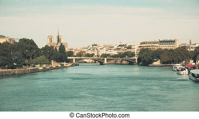 The Seine river embankments and famous Notre-Dame Cathedral...