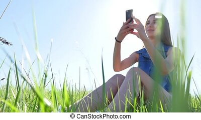 The Selfie girl. Woman doing selfie on smartphone on nature, self lifestyle