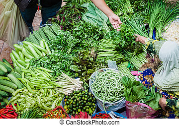 The purchaser takes the product from the seller at the vegetable market