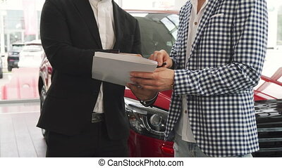 The seller and the buyer put their signatures on the contract