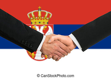 The Serbian flag and business handshake