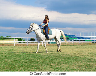 The serenity young girl astride a horse. Shallow DOF