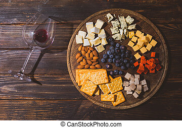 The set of different snacks for red wine