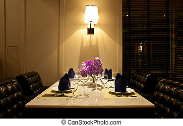 The set of table for dinner with leather chair