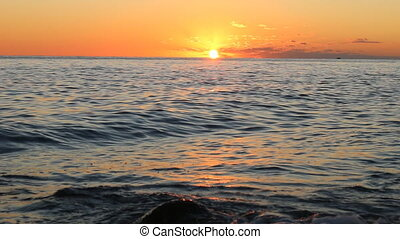 The setting sun hangs over the waters of the Black sea