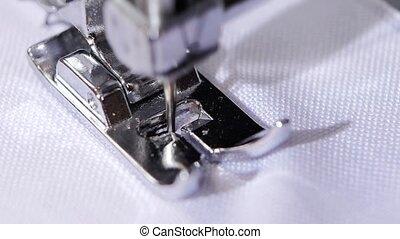 The sewing machine sews a zigzag stitch. Close up. Slow motion