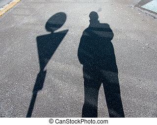 shadow of a man - the shadow of a man on a sidewalk....
