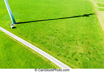 the shadow of a modern wind turbine from above