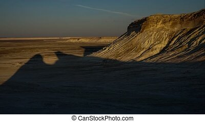 The shadow of the cliff at dawn