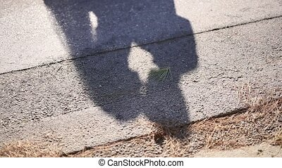 The shadow of the couple on the floor. Silhouette of the shadow