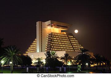 The Sheraton hotel illuminated at night, Doha Qatar. Photo...