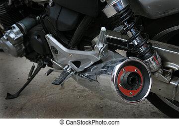 The shining muffler of a modern sports motorcycle