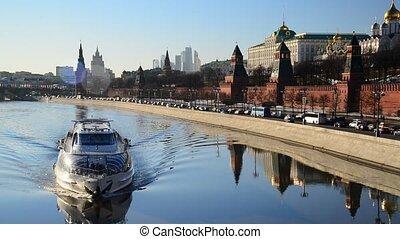 The ship floats on  river near  Kremlin