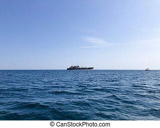 The ship on horizon in Black sea. Crimea