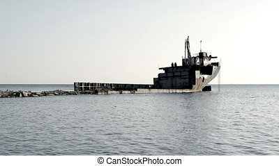 The Ship Ran Aground On The Beach After The Storm, Rusting Ship In The Sea