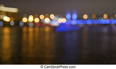 The ship sails on the river at night. Abstract background