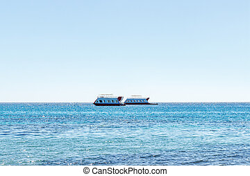 The ship sails on the sea. tourist boat. Sea ships against the background of a beautiful sky