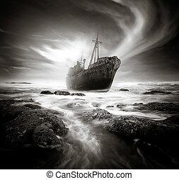 The Shipwreck - Shipwreck along a rough and rocky coastline.