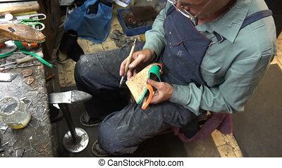 the shoemaker at work.The process of repairing shoes in workshop