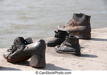 The Shoes on the Danube Promenade is a war memorial and was created by the sculptor Gyula Pauer on the bank of the Danube River in Budapest. It honours the Jews who were killed in Budapest during World War II the Arrow Cross Militia group. They were ordered to take off their shoes, and were shot at ...