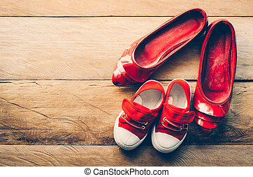 The shoes of mother and baby - concept take care
