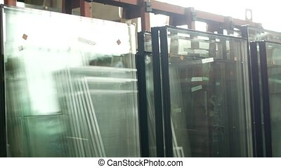 The shop for the production and manufacture of PVC windows, ready-made double-glazed windows stand in the shop for further assembly of PVC windows, manufacturing