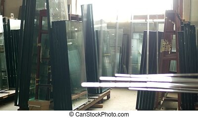 The shop for the production and manufacture of PVC windows, ready-made double-glazed windows stand in the shop for further assembly of PVC windows, insulating